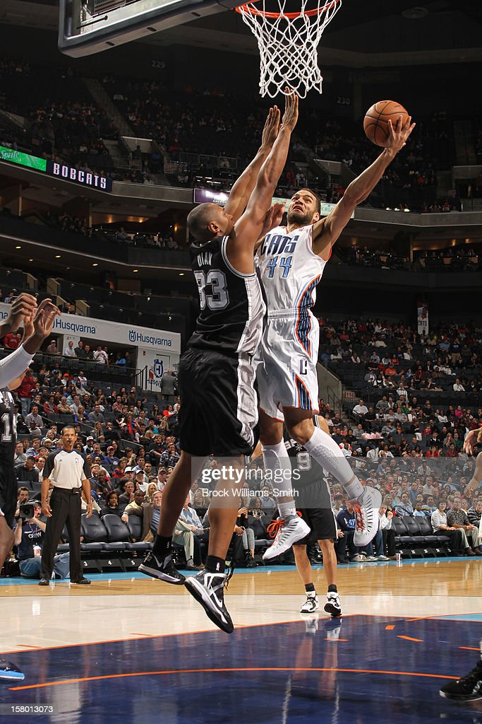 Jeffrey Taylor #44 of the Charlotte Bobcats shoots against Boris Diaw #33 of the San Antonio Spurs at the Time Warner Cable Arena on December 8, 2012 in Charlotte, North Carolina.