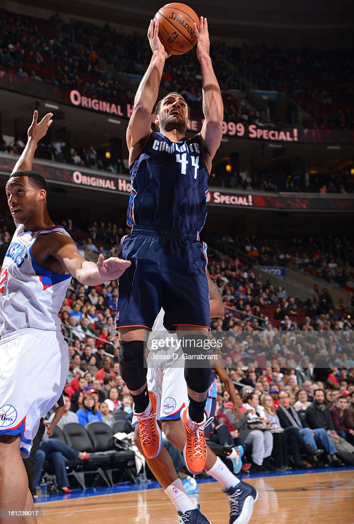 Jeffrey Taylor #44 of the Charlotte Bobcats shoots against Evan Turner #12 of the Philadelphia 76ers during the game at the Wells Fargo Center on February 9, 2013 in Philadelphia, Pennsylvania.
