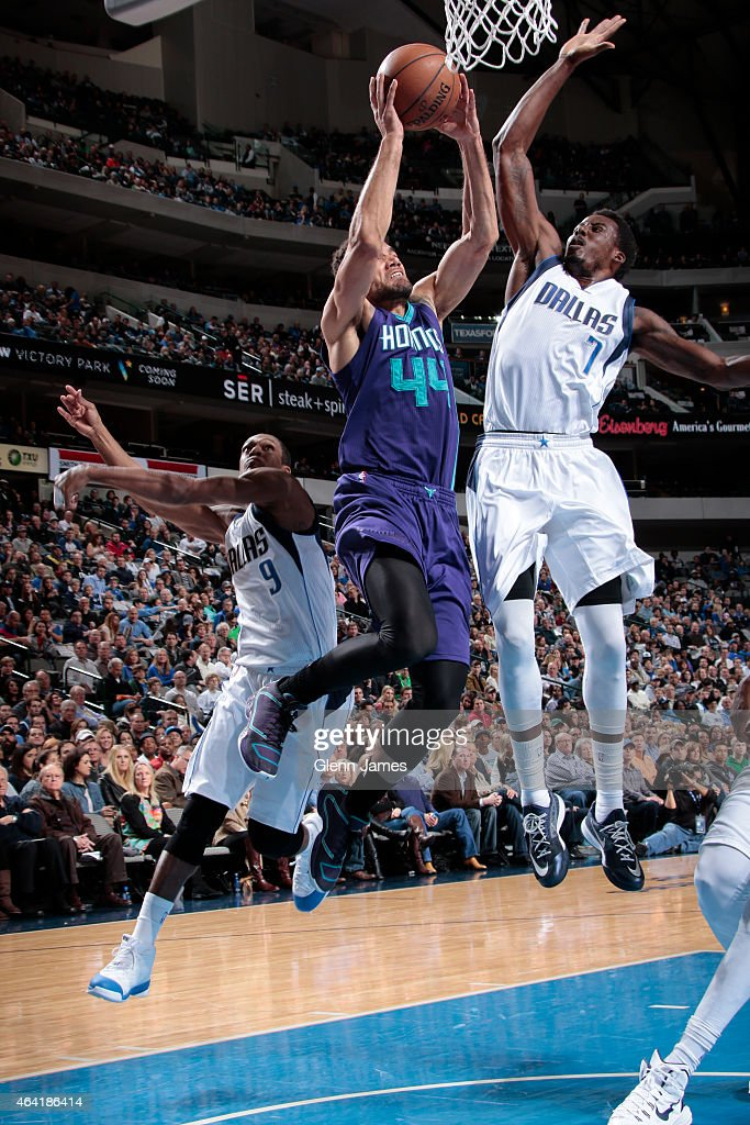 Jeffrey Taylor of the Charlotte Hornets goes in for the layup against AlFarouq Aminu of the Dallas Mavericks on February 22 2015 at the American...