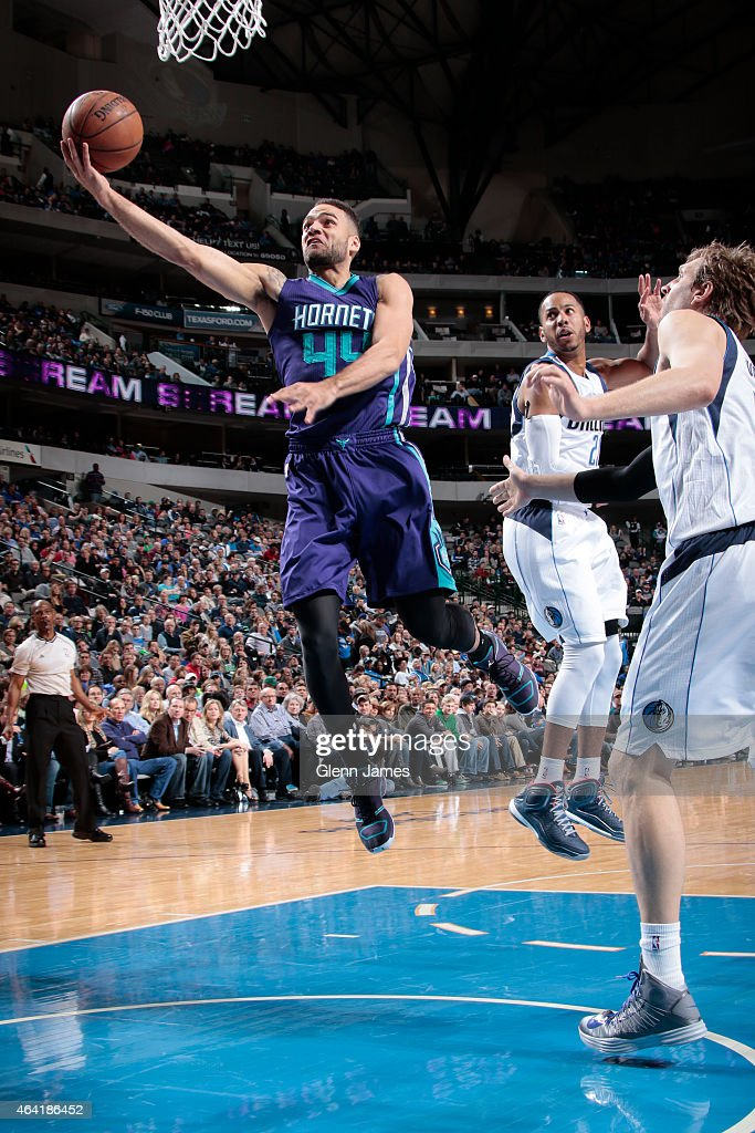 Jeffrey Taylor of the Charlotte Hornets goes in for the layup against the Dallas Mavericks on February 22 2015 at the American Airlines Center in...