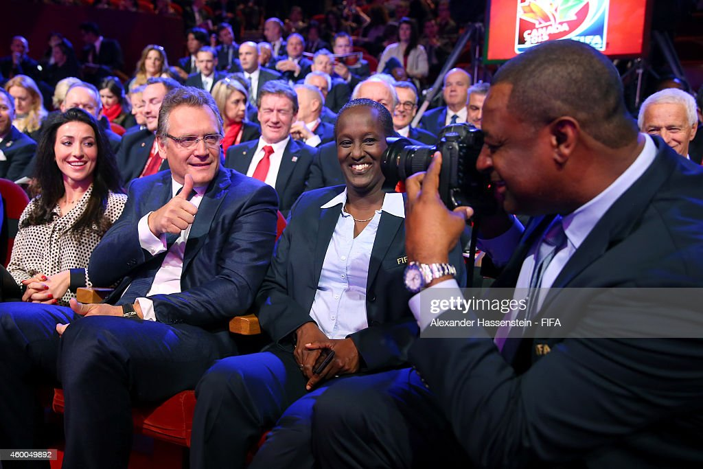 Jeffrey Webb (R), FIFA Vice-President and CONCACAF President takes pictures of FIFA Secretary General Jerome Valcke (2nd L) prior to the Final Draw for the FIFA Women's World Cup Canada 2015 at Canadian Museum of History on December 6, 2014 in Ottawa, Canada.