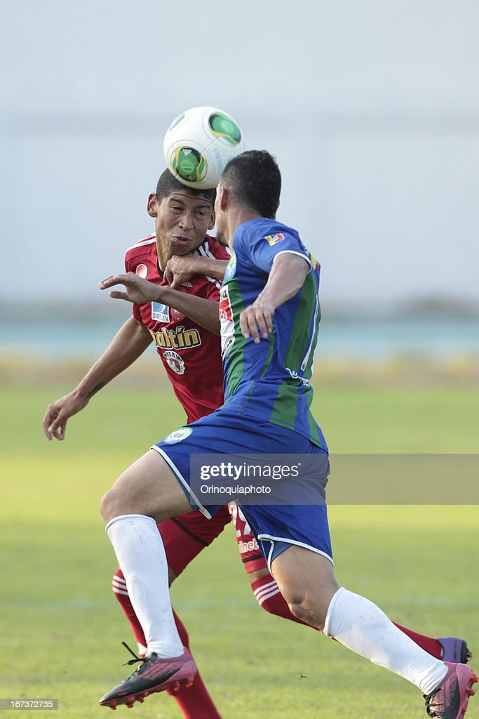 Jefre Vargas of Caracas FC fights for the ball during a match between Llaneros de Guanare and Caracas FC as part of the Clausura Tournament 2013 at the Estadio Olimpico Rafael Calles Pinto on April 24, 2013 in Guanare, Venezuela.