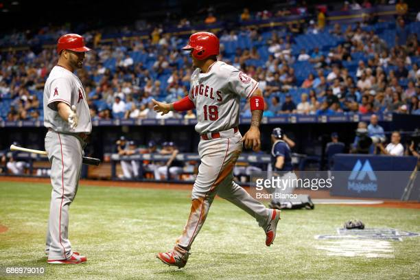 Jefry Marte of the Los Angeles Angels celebrates with Albert Pujols after Marte scored on a wild pitch by Ryne Stanek of the Tampa Bay Rays during...