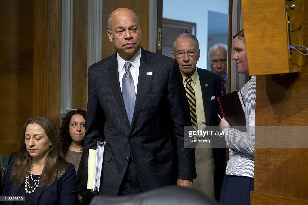 <a gi-track='captionPersonalityLinkClicked' href=/galleries/search?phrase=Jeh+Johnson&family=editorial&specificpeople=5862084 ng-click='$event.stopPropagation()'>Jeh Johnson</a>, U.S. secretary of Homeland Security (DHS), center, arrives to a Senate Judiciary Committee hearing with Senator Charles 'Chuck' Grassley, a Republican from Iowa and chairman of the Senate Judiciary Committee, center right, and Senator Patrick Leahy, a Democrat from Vermont, in Washington, D.C., U.S., on Thursday, June 30, 2016. Johnson said gun control is a matter of homeland security during the hearing. Photographer: Andrew Harrer/Bloomberg via Getty Images