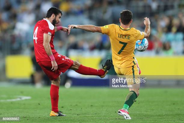 Jehad Al Baour of Syria and Matthew Leckie of Australia compete during the 2018 FIFA World Cup Asian Playoff match between the Australian Socceroos...
