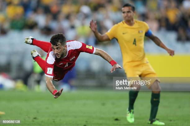 Jehad Al Baour of Syria heads the ball during the 2018 FIFA World Cup Asian Playoff match between the Australian Socceroos and Syria at ANZ Stadium...