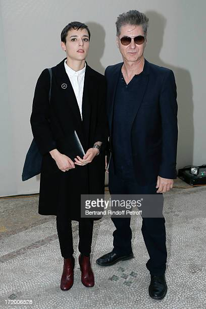 Jehnny Beth and Etienne Daho attend Yves Saint Laurent Menswear Spring/Summer 2014 show as part of Paris Fashion Week on June 30 2013 in Paris France