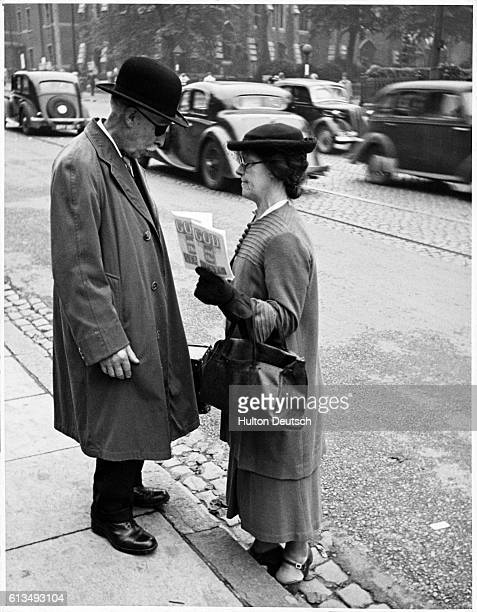 A Jehovah's Witness catches the attention of an elderly passerby