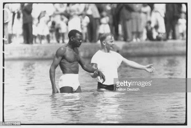 A Jehovah's Witness member receives his baptism by immersion in water at Hyde Park in London