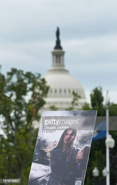 A 'Jehovah's Witnesses' sign sits in front of Union Station with the US Capitol dome as a back drop Members of the Jehovah's Witnesses church are in...