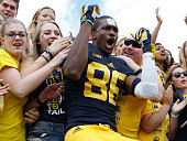 Jehu Chesson of the Michigan Wolverines celebrates a 287 victory over the UNLV Rebels with fans on September 19 2015 at Michigan Stadium in Ann Arbor...