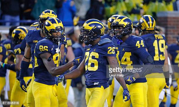 Jehu Chesson of the Michigan Wolverines congratulates teammate Jourdan Lewis for a game ending interception in the fourth quarter at Michigan Stadium...