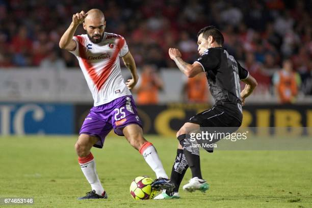 Jehu Chiapas of Veracruz and Celso Ortiz of Monterrey fight for the ball during the 16th round match between Veracruz and Monterrey as part of the...
