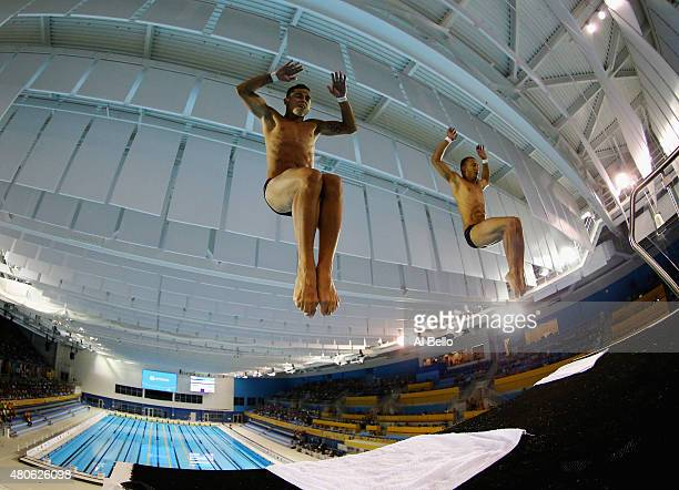 Jeinkler Aguirre and Jose Antonio Guerra of Cuba dive during the Men's Synchronised 10m Platform Final at the Pan Am Games on July 13 2015 in Toronto...
