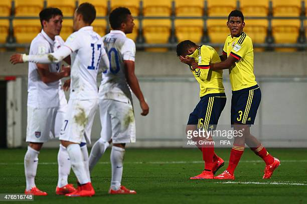 Jeison Angulo of Colombia comforts team mate Jarlan Barrera as players of USA celebrate after the FIFA U20 World Cup New Zealand 2015 Round of 16...