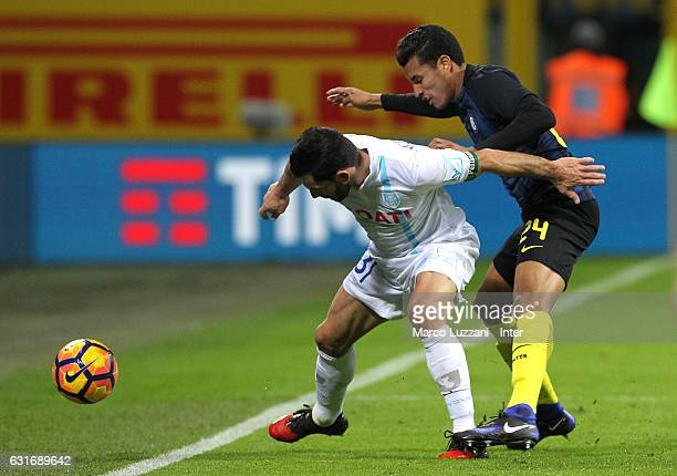 Jeison Murillo of FC Internazionale competes for the ball with Sergio Pellissier of AC ChievoVerona during the Serie A match between FC...