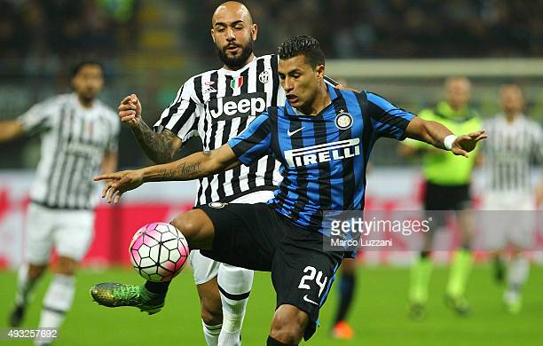 Jeison Murillo of FC Internazionale Milano competes for the ball with Simone Zaza of Juventus FC during the Serie A match between FC Internazionale...