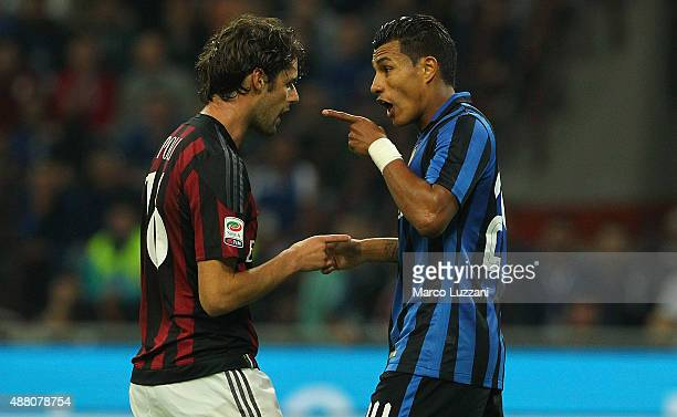 Jeison Murillo of FC Internazionale Milano disputes with Andrea Poli of AC Milan during the Serie A match between FC Internazionale Milano and AC...