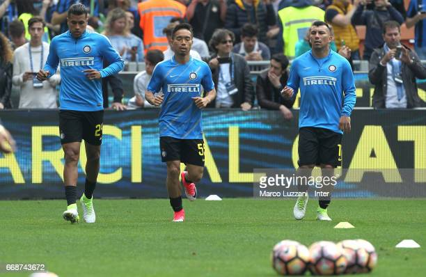 Jeison Murillo Yuto Nagatomo and Gary Medel of FC Internazionale warm up ahead of the Serie A match between FC Internazionale and AC Milan at Stadio...