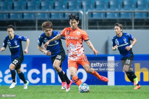 Jeju United Defender Chung Woon fights for the ball with Gamba Osaka Midfielder Doan Ritsu during the AFC Champions League 2017 Group H match Between...