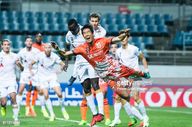 Jeju United Defender Kim Wonil fights for the ball with Adelaide United Forward Papa Babacar Diawara during the AFC Champions League 2017 Group Stage...