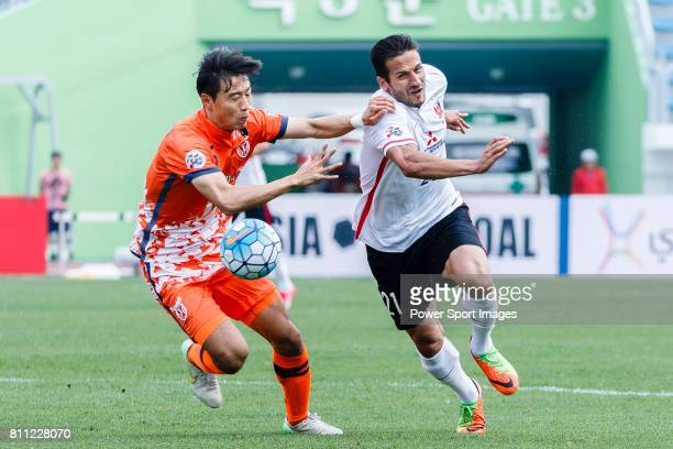 Jeju United Defender Kweon Hanjin fights for the ball with Urawa Reds Forward Zlatan Ljubijankic during the AFC Champions League 2017 Round of 16...