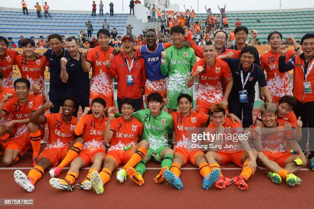 Jeju United FC celebrate after the AFC Champions League Round of 16 match between Jeju United FC and Urawa Red Diamonds at Jeju World Cup Stadium on...