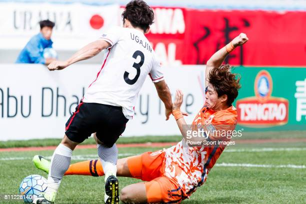 Jeju United Forward Ahn Hyunbeom trips up with Urawa Reds Midfielder Ugajin Tomoya during the AFC Champions League 2017 Round of 16 match between...