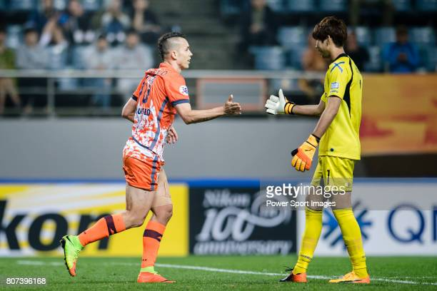 Jeju United Forward Marcelo Toscano high five with Gamba Osaka Goalkeeper Higashiguchi Masaaki during the AFC Champions League 2017 Group H match...