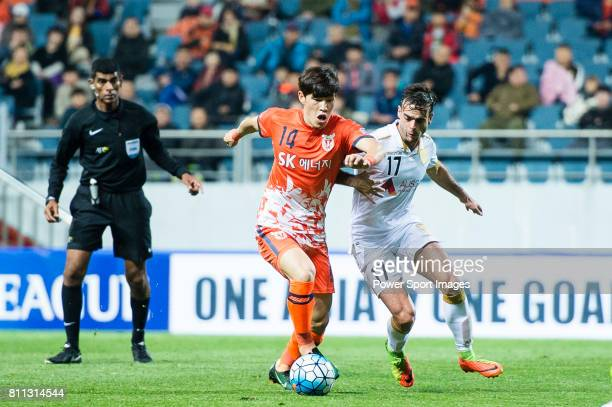 Jeju United Midfielder Lee Changmin in action against Adelaide United Forward Nikola Mileusnic during the AFC Champions League 2017 Group Stage Group...