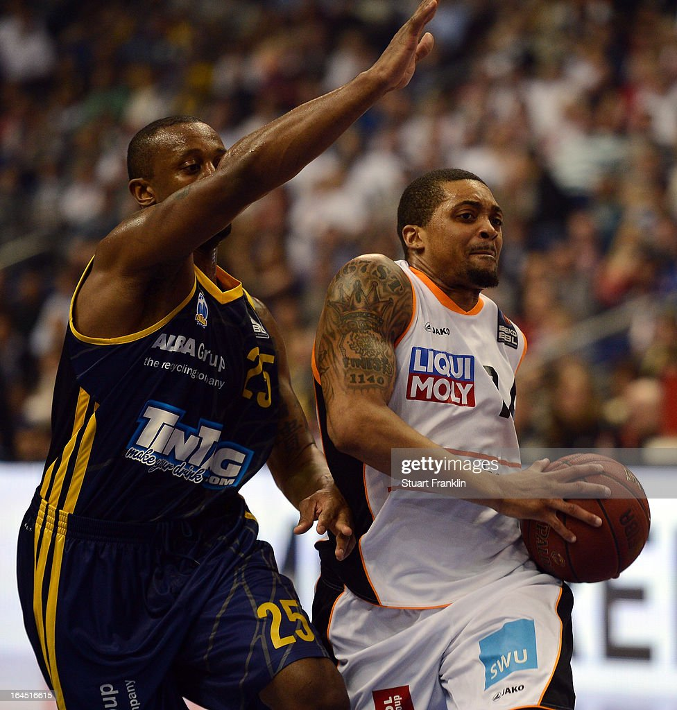 JeKel Foste of Berlin challenges Alan Ray of Ulm during the Beko BBLTop Four final game between Ratiopharm Ulm and Alba Berlin at O2 World on March 24, 2013 in Berlin, Germany.
