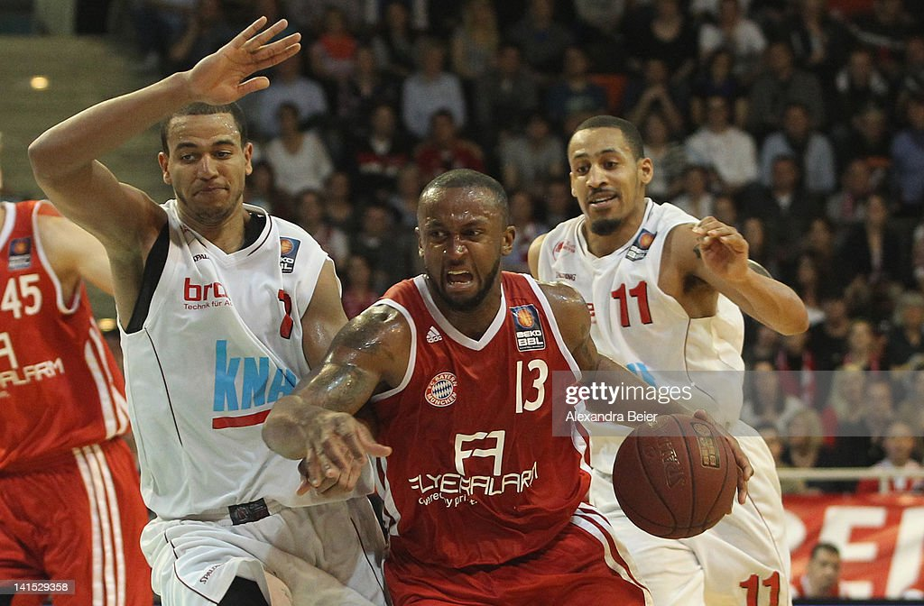Je'Kel Foster of Bayern Muenchen fights for the ball with Alex King and John Little of sOliver Baskets Wuerzburg during the basketball Bundesliga...