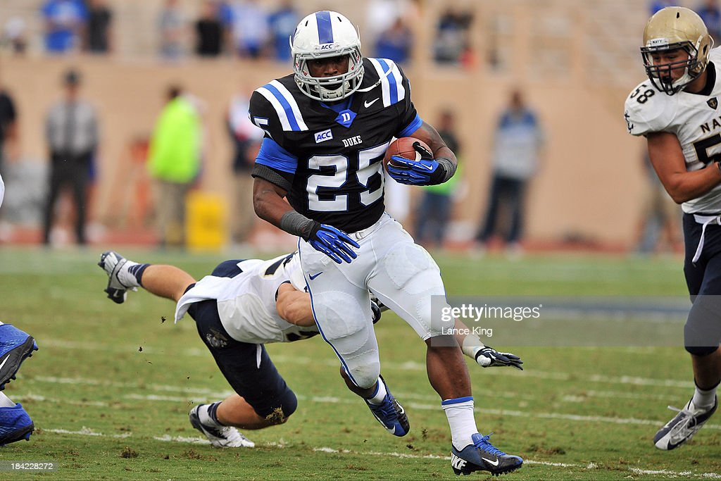 Jela Duncan #25 of the Duke Blue Devils runs with the ball against the Navy Midshipmen at Wallace Wade Stadium on October 12, 2013 in Durham, North Carolina. Duke defeated Navy 35-7.