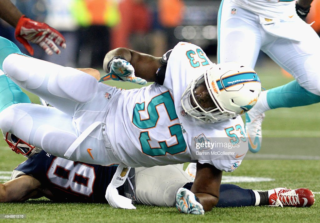 <a gi-track='captionPersonalityLinkClicked' href=/galleries/search?phrase=Jelani+Jenkins&family=editorial&specificpeople=5653455 ng-click='$event.stopPropagation()'>Jelani Jenkins</a> #53 of the Miami Dolphins is tackled during the first quarter against the New England Patriots at Gillette Stadium on October 29, 2015 in Foxboro, Massachusetts.