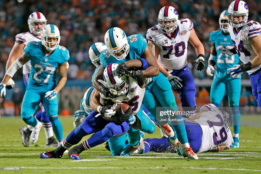 <a gi-track='captionPersonalityLinkClicked' href=/galleries/search?phrase=Jelani+Jenkins&family=editorial&specificpeople=5653455 ng-click='$event.stopPropagation()'>Jelani Jenkins</a> #53 of the Miami Dolphins tackles <a gi-track='captionPersonalityLinkClicked' href=/galleries/search?phrase=Boobie+Dixon&family=editorial&specificpeople=13579215 ng-click='$event.stopPropagation()'>Boobie Dixon</a> #26 of the Buffalo Bills during fourth quarter action on November 13, 2014 at Sun Life Stadium in Miami Gardens, Florida. The Dolphins defeated the Bills 22-9.