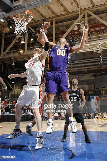Jelani McCoy of the Blue team battles for a rebound against Lance Allred of the Red team during the DLeague AllStar Game Presented by Spalding during...