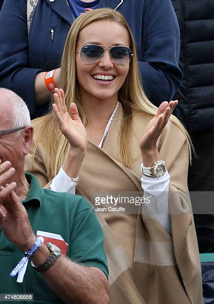 Jelena Djokovic applauds husband Novak Djokovic after his victory on day 3 of the French Open 2015 at Roland Garros stadium on May 26 2015 in Paris...