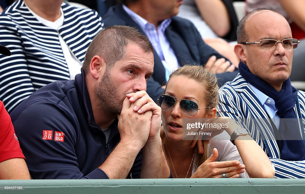 Jelena Djokovic wife of Novak Djokovic talks with his Physio, Miljan Amanovic during the Men's Singles second round match between Novak Djokovic of Serbia and Steve Darcis of Belgium on day five of the 2016 French Open at Roland Garros on May 26, 2016 in Paris, France.
