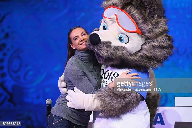Jelena Issinbajewa pose with Zabivaka the Official Mascot for the 2018 FIFA World Cup Russia during the behind the scenes event at the main hall for...
