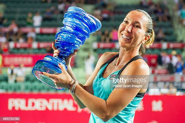Jelena Jankovic of Serbia celebrates with the trophy after winning her match against Angelique Kerber of Germany during the WTA Prudential Hong Kong...