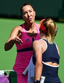 Jelena Jankovic of Serbia consoles Lesia Tsurenko of Ukraine after she retired injured in the second set of their quarterfinal match at the BNP...