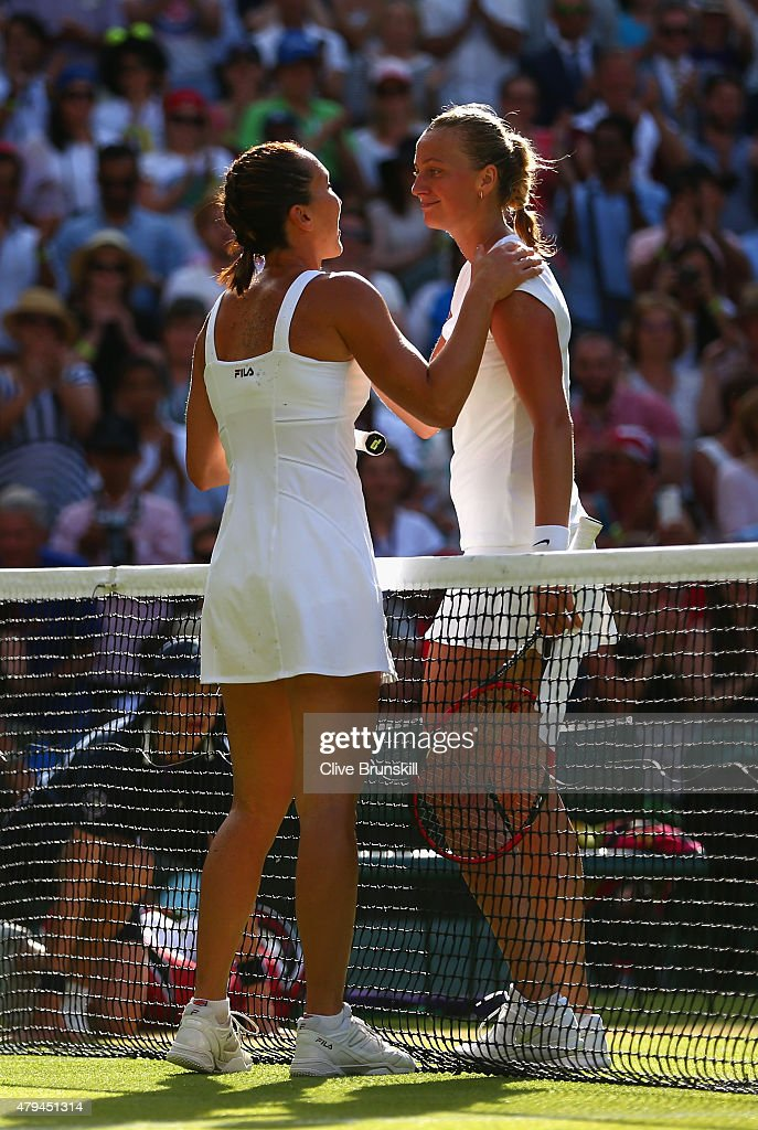 Jelena Jankovic of Serbia consoles Petra Kvitova of Czech Republic after victory in their Ladies' Singles third Round match during day six of the...