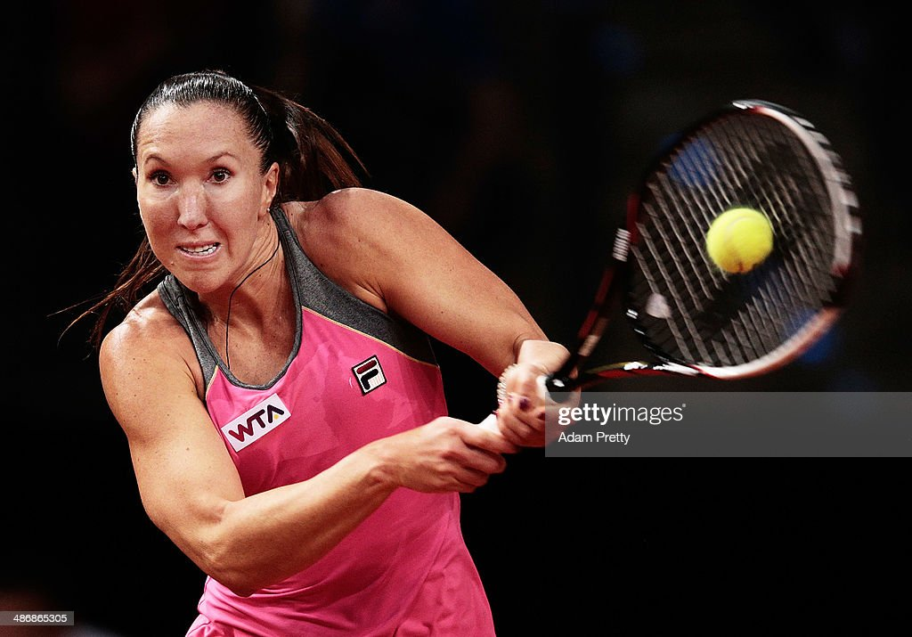 <a gi-track='captionPersonalityLinkClicked' href=/galleries/search?phrase=Jelena+Jankovic&family=editorial&specificpeople=217552 ng-click='$event.stopPropagation()'>Jelena Jankovic</a> of Serbia hits a backhand during her semi final match against Ana Ivanovic of Serbia on day six of the Porsche Tennis Grand Prix at Porsche Arena on April 26, 2014 in Stuttgart, Germany.