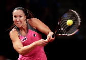 Jelena Jankovic of Serbia hits a backhand during her semi final match against Ana Ivanovic of Serbia on day six of the Porsche Tennis Grand Prix at...