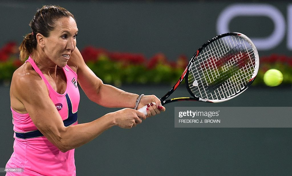 Jelena Jankovic of Serbia hits a backhand return to Sabine Lisicki of Germany during their semifinal match at the BNP Paribas Tennis Open in Indian...