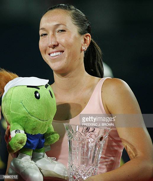Jelena Jankovic of Serbia holds her runnerup trophy and mascot doll after her match against Agnes Szavay in the China Open tennis final in Beijing 23...