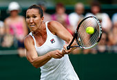 Jelena Jankovic of Serbia plays a backhand against Evgeniya Rodina of Russia in her Women's Singles Second Round match during day four of the...