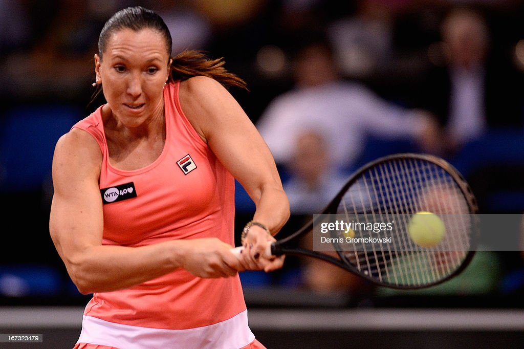 <a gi-track='captionPersonalityLinkClicked' href=/galleries/search?phrase=Jelena+Jankovic&family=editorial&specificpeople=217552 ng-click='$event.stopPropagation()'>Jelena Jankovic</a> of Serbia plays a backhand in her match against Samantha Stosur of Australia during Day 3 of the Porsche Tennis Grand Prix at Porsche-Arena on April 24, 2013 in Stuttgart, Germany.