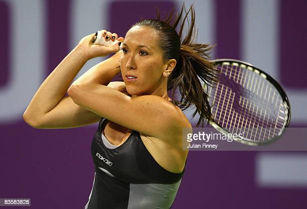 Jelena Jankovic of Serbia plays a backhand in her match against Svetlana Kuznetsova of Russia during the Sony Ericsson Championships at the Khalifa...