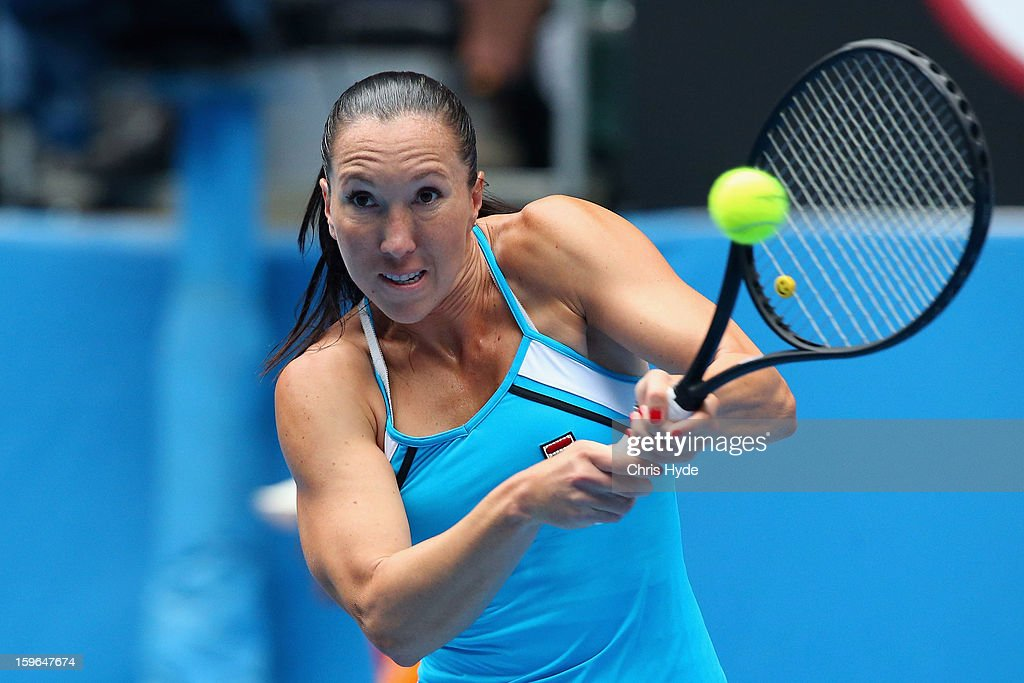 Jelena Jankovic of Serbia plays a backhand in her third round match against Ana Ivanovic of Serbia during day five of the 2013 Australian Open at Melbourne Park on January 18, 2013 in Melbourne, Australia.
